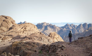 Mount Sinai, Egypt - May 24, 2010: A man hikes down from the summit of Mount Sinai in Egypt after watching the sunrise.