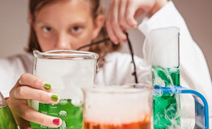 Young girl experimenting in the lab.