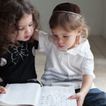 Brother and sister studying the Aleph Bet together
