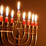 Candles lit for the eighth night of Hanukkah