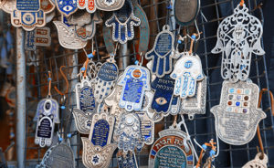 Hands of Fatima- Hamsa- to keep away bad omens and atract good luck, at the flea market for sale at the flea market in Jaffa.Israel,