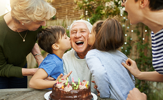Shot of a happy family celebrating a birthday together outside