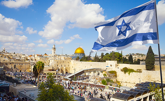 Israel flag with a view of old city Jerusalem and the KOTEL- Western wall