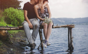 A couple enyoing and relaxing by the lake.