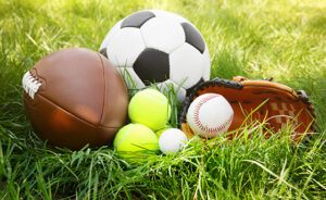 Group of sport equipment on green grass