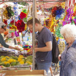 Tel Aviv, Israel- September 18, 2013: Vendors and buyers at the Sukkot Market in Rabin Square, looking at Etrog and Lulav (the for species) and decorations for the Jewish Festival of Sukkot.