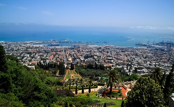 Overview of Haifa coast along Mediterranean Sea, where naval port and Bahai Gardens reside, seen from Mount Carmel