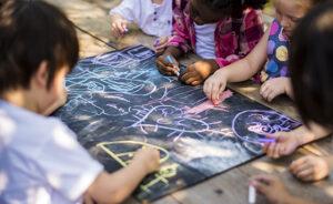 Children drawing art class outdoors