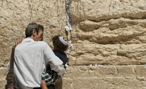 Father and Son praying at the Wailing Wall